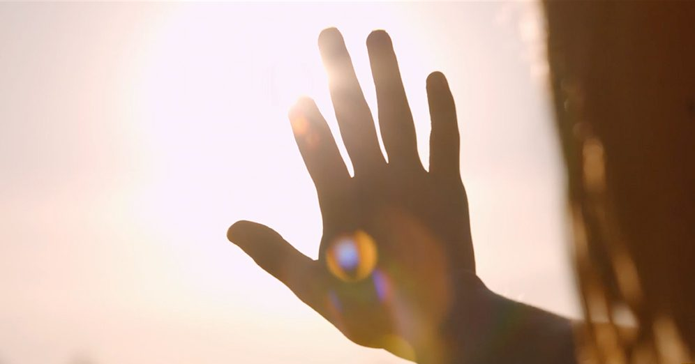 Hand in the sun image